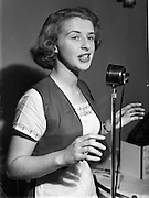 13/10/1952<br /> 10/13/1952<br /> 13 October 1952<br /> Miss Maureen Browne, singing waitress at Caravan Restaurant(?)