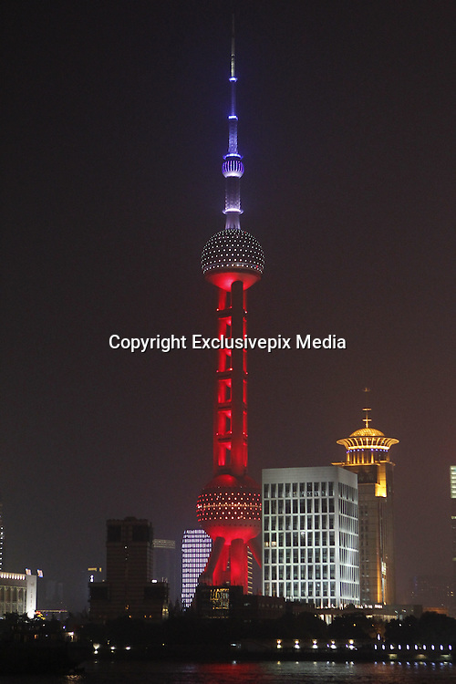 SHANGHAI, CHINA - NOVEMBER 14: (CHINA OUT) <br /> <br /> The Oriental Pearl Tower is lighted up in red, white and blue colors of French national flag to mourn the victims in French terror attack on November 14, 2015 in Shanghai, China. French suffered savage terror attach Friday night at Stade de France and a central restaurant as well as several other places which caused at least 128 dead, with 250 people wounded, 99 in critical situation, said local media. <br /> ©Exclusivepix Media