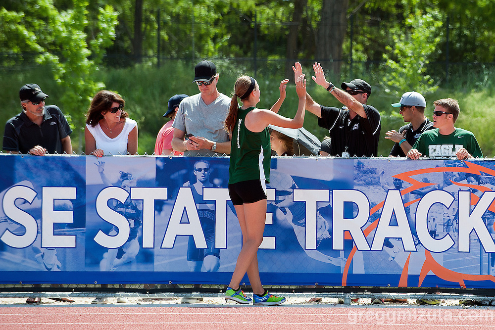 Eagle sophomore Jenny Stevens high fives Coach Greg Harm after winning the Idaho 5A State Track & Field Championships high jump event at Dona Larsen Park, Boise, Idaho on May 17, 2014. Steven cleared 5-4.00.