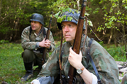 Reenactors from Northern World War Two Association, dressed as elements of the Elite Gross Deutschland Division, waiting for the return of reconnaissance party during a private 24hr excerise, held at Sutton Grange, near Ripon in