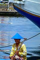 Indonesia, Java, Jakarta. Sunda Kelapa, the old harbor. Old man in blue hat.