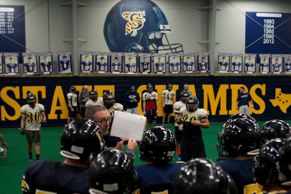 Coach Kreg Kimple calls the play for the offense during practice at Stephenville High School in Stephenville, Texas on November 5, 2013. (Cooper Neill / for The New York Times)