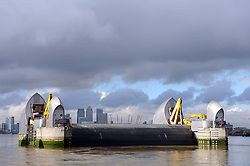 © Licensed to London News Pictures. 10/02/2014<br />  The Thames Barrier has been partly opened this afternoon (10.02.2014)below sunshine and dark rain clouds.<br /> The Environment agency warning of severe flooding along the River Thames in Oxfordshire and Surrey with sixteen areas at risk.<br /> Photo credit :Grant Falvey/LNP