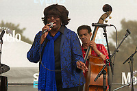 The 12th annual Hyde Park Jazz Festival was held this weekend, Saturday, September 29th and Sunday, September 30th, 2018 at various venues around Hyde Park. Jazz musicians from all around came out to play at the two-day event. <br /> <br /> 3337 &ndash; Lady T performed Sunday afternoon during a tribute to the late John Wright on the Midway Plaisance located at 1130 Midway Plaisance on the University of Chicago campus.<br /> <br /> Please 'Like' &quot;Spencer Bibbs Photography&quot; on Facebook.<br /> <br /> Please leave a review for Spencer Bibbs Photography on Yelp.<br /> <br /> Please check me out on Twitter under Spencer Bibbs Photography.<br /> <br /> All rights to this photo are owned by Spencer Bibbs of Spencer Bibbs Photography and may only be used in any way shape or form, whole or in part with written permission by the owner of the photo, Spencer Bibbs.<br /> <br /> For all of your photography needs, please contact Spencer Bibbs at 773-895-4744. I can also be reached in the following ways:<br /> <br /> Website &ndash; www.spbdigitalconcepts.photoshelter.com<br /> <br /> Text - Text &ldquo;Spencer Bibbs&rdquo; to 72727<br /> <br /> Email &ndash; spencerbibbsphotography@yahoo.com<br /> <br /> #SpencerBibbsPhotography #HydePark #Community #Neighborhood<br /> #Music<br /> #HydeParkJazzFestival<br /> #Jazz<br /> #LiveMusic