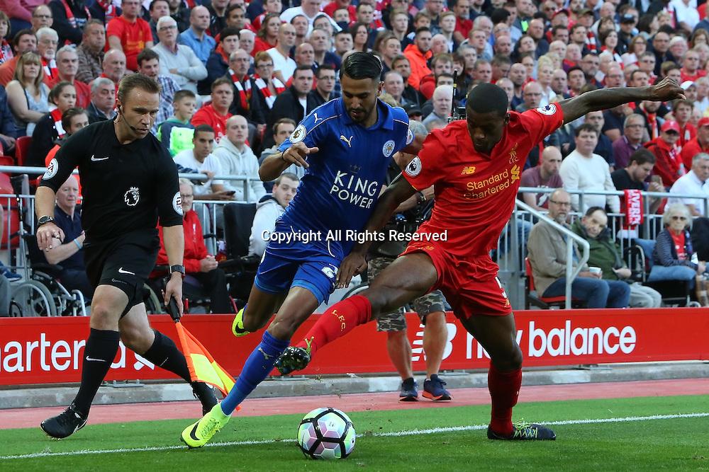 10.09.2016. Anfield, Liverpool, England. Premier League Football. Liverpool versus Leicester. Georginio Wijnaldum of Liverpool   tackles Riyad Mahrez of Leicester City