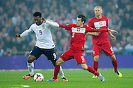 (L) England's Daniel Sturrige fights for the ball with (R) Poland's Waldemar Sobota during the 2014 World Cup Qualifying Group H football match between England and Poland at Wembley Stadium in London on October 15, 2013.<br /> <br /> Great Britain, London, October 15, 2013<br /> <br /> Picture also available in RAW (NEF) or TIFF format on special request.<br /> <br /> For editorial use only. Any commercial or promotional use requires permission.<br /> <br /> Mandatory credit:<br /> Photo by © Adam Nurkiewicz / Mediasport