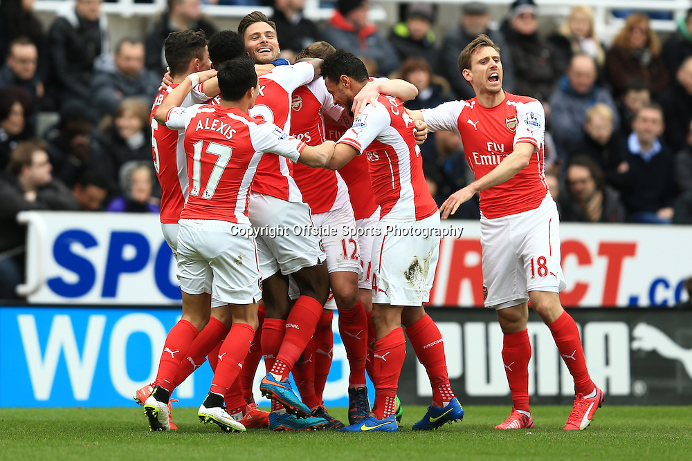 21 March 2015 - Barclays Premier League - Newcastle United v Arsenal - Olivier Giroud of Arsenal celebrates scoring his 1st goal with team mates - Photo: Marc Atkins / Offside.