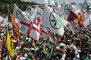 Flags of Lega Nord (Northern League party) at a meeting in Pontida, Sunday, June 14, 2009. The flag with the green camuno rose (ancient symbol of inhabitants of Valcamonica) on a white field is the symbol of Padania Nation an ideal nation comprises the northern regions of Italy close to Po river valley.