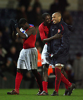 Photo: Paul Thomas.<br /> Blackburn Rovers v Arsenal. The Barclays Premiership. 13/01/2007.<br /> <br /> Arsenal goal scorer Thierry Henry (R) and his replacement Emmanuel Adebayor share a moment after their win.