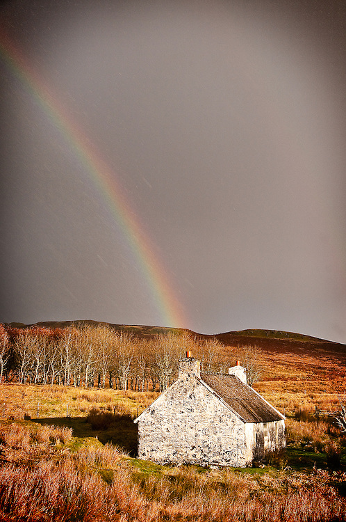 Rainbow hits ancient stone cottage on Isle of Skye
