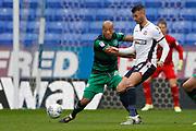 Queens Park Rangers defender Alex John-Baptiste (20) and Bolton Wanderers striker Gary Madine (14) during the EFL Sky Bet Championship match between Bolton Wanderers and Queens Park Rangers at the Macron Stadium, Bolton, England on 21 October 2017. Photo by Craig Galloway.
