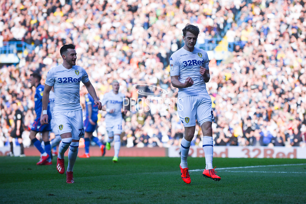 Patrick Bamford of Leeds United (9) scores a goal from a penalty and celebrates with Jack Harrison of Leeds United (22) to make the score 1-0 during the EFL Sky Bet Championship match between Leeds United and Bolton Wanderers at Elland Road, Leeds, England on 23 February 2019.