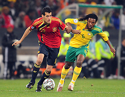 Sergio Busquets and Macbeth Sabaya  during the soccer match of the 2009 Confederations Cup between Spain and South Africa played at the Freestate Stadium,Bloemfontein,South Africa on 20 June 2009.  Photo: Gerhard Steenkamp/Superimage Media.