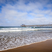 Photo of Newport Beach Pier in Orange County California. Newport Pier is on Balboa Peninsula and is a popular destination for locals and tourists. Newport Beach is an affluent beach community along the Pacific Ocean in Orange County Southern California. Photo is high resolution and was taken in 2012.
