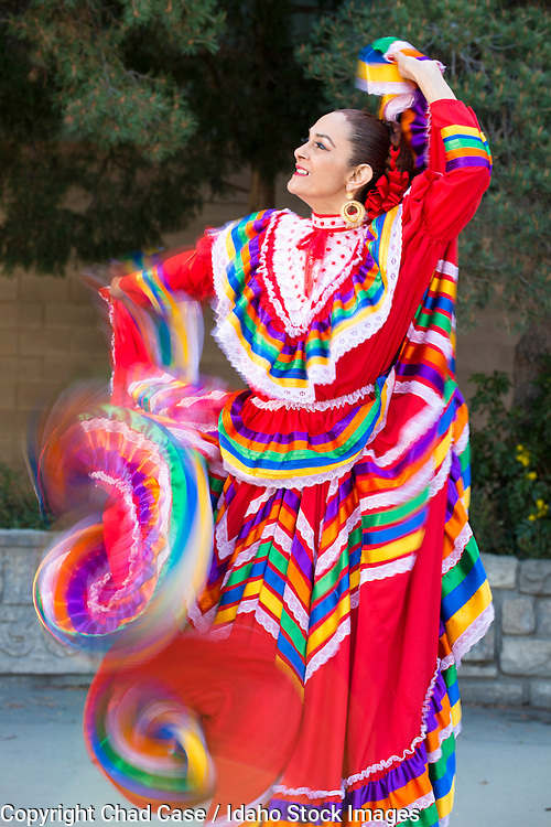 Woman dances a traditional dance in the Boise sun.  Model released.