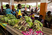 Women at the local market in Lenakel on Tanna Island, the markets are held every Monday, Wednesday and Friday and are an important trading hub for the islanders.