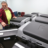 Tracy Fondren, a Lee County Employee, gets a voting machine from his district, district 2, as he and other county employees load voting machines from the Lee County Justice Center on Monday morning in Tupelo.