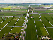 Nederland, Noord-Holland, Gemeente Schermer, 16-04-2012; Polder De Schermer gezien langs de as van de de Zuidervaart, het Alkmaardermeer aan de horizon..Polder De Schermer (NW Netherlands) shows land division with farmhouses along a straight canal..luchtfoto (toeslag), aerial photo (additional fee required);.copyright foto/photo Siebe Swart