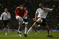 Photo: Paul Thomas.<br /> England v Spain. International Friendly. 07/02/2007.<br /> <br /> David Villa tries a shot past England's Rio Ferdinand (R).