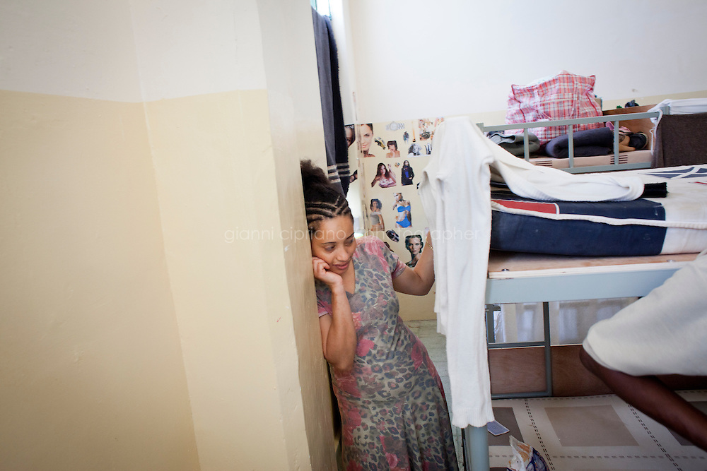 HAL FAR, MALTA - JUNE 20: An Ethiopian immigrant that arrived from Libya stays in her room at the Lyster Barracks Closed Center, a detention center for immigrants in Hal Far (which translates as Rats' town), Malta, on June 20, 2011. All immigrants who enter in Malta illegally are detained. Upon arrival to Malta, irregular migrants and asylum seekers are sent to one of three dedicated immigration detention facilities: the Lyster Barracks Closed Centre, the Safi Closed Centre, and the Ta'kandja Closed Centre. Once apprehended by the authorities, immigrants remain in detention even after they apply for refugee status. detention lasts as long as it takes for asylum claims to be determined. This usually takes months; asylum seekers often wait five to 10 months for their first interview with the Refugee Commissioner. Asylum seekers may be detained for up to 12 months: at this point, if their claim is still pending, they are released and transferred to an Open Center.