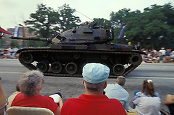 Americana spectators watch army tank in review