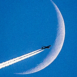 British Airways flight  passes the moon in it's Waxing Crescent Phase