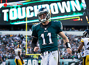Sep 25, 2016; Philadelphia, PA, USA; Philadelphia Eagles quarterback Carson Wentz (11) reacts after his 73 yard touchdown pass against the Pittsburgh Steelers during the third quarter at Lincoln Financial Field. Mandatory Credit: Bill Streicher-USA TODAY Sports