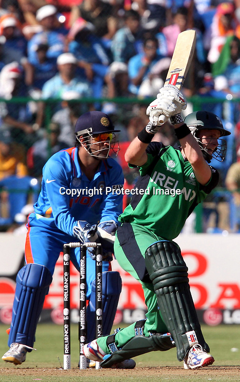 Ireland batsman William Porterfield plays a shot against India during the ICC Cricket World Cup - 22nd Match, Group B, India vs Ireland Played at M Chinnaswamy Stadium, Bangalore, 6 March 2011 - day/night (50-over match)