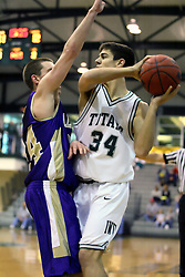 30 December 2006: Drew Hilton presses Jason Bloom to pass. The Titans outscored the Britons by a score of 94-80. The Britons of Albion College visited the Illinois Wesleyan Titans at the Shirk Center in Bloomington Illinois.<br />