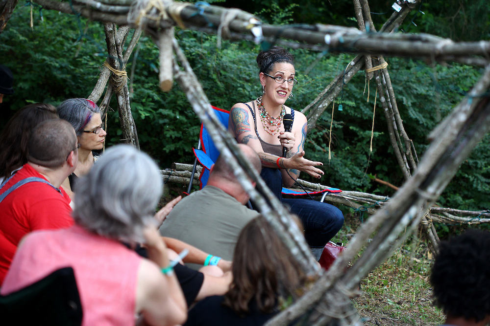 Denver pastor and author Nadia Bolz-Weber speaks with a group in an outdoor geodesic dome at the Wild Goose Festival at Shakori Hills in North Carolina June 23, 2011.  (Photo by Courtney Perry)