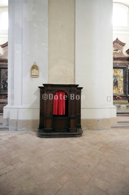 confessional dwarfed in a very big church