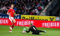 30.05.2014, Tivoli Stadion, Innsbruck, AUT, Fussball Testspiel, Oesterreich vs Island, im Bild (v.l.) Marc Janko (AUT), Hannes Por Halldorsson (ISL) // Marc Janko (AUT) (L) in action against Hannes Por Halldorsson (ISL) during the International Friendly between Austria and Iceland at the Tivoli Stadion in Innsbruck, Austria on 2014/05/30. EXPA Pictures © 2014, PhotoCredit: EXPA/ Johann Groder