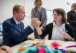 © Licensed to London News Pictures. 16/05/2017. Portsmouth, UK. Liberal Democrat party leader Tim Farron shakes hands with Shanon a student at the Mary Rose Academy special needs school as head teacher Alison Beane looks on. The Lib Dems have today announced plans for education and business during campaigning for the general election on June 8, 2017.  Photo credit: Peter Macdiarmid/LNP