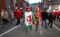 Wales fans in fancy dress arrive for the Guinness Six Nations match at the Principality Stadium, Cardiff.
