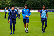 Wimbledon midfielder Anthony Hartigan (8) Wimbledon defender Will Nightingale (5) and Wimbledon forward James Hanson (18) on the pitch ahead of the Pre-Season Friendly match between Hampton & Richmond and AFC Wimbledon at Beveree Stadium, Richmond Upon Thames, United Kingdom on 27 July 2019.