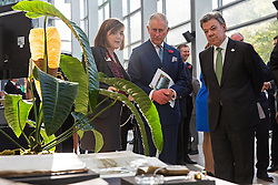 The Prince of Wales and Colombian President Juan Manuel Santos (right) are shown a natural history display by Professor Kathy Willis, Director of Science at the Royal Botanic Gardens in Kew (left), in the Darwin Centre at the Natural History Museum in London.