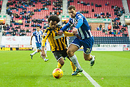 Yanic Wildschut of Wigan Athletic is challenged by Junior Brown of Shrewsbury Town during the Sky Bet League 1 match at the DW Stadium, Wigan<br /> Picture by Matt Wilkinson/Focus Images Ltd 07814 960751<br /> 21/11/2015