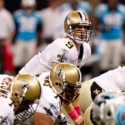 October 3, 2010; New Orleans, LA, USA; New Orleans Saints quarterback Drew Brees (9) under center against the Carolina Panthers during the first quarter at the Louisiana Superdome. Mandatory Credit: Derick E. Hingle