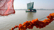 Sailing boat and marigold garlands on the river Ganges in Uttar Pradesh, India