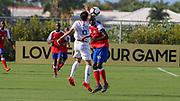 Team USA  forward Christian Torres (9) and Team Haiti midfielder Gulberson Choune (8) vie for the header during a CONCACAF boys under-15 championship soccer game, Sunday, Aug. 4, 2019, in Bradenton, Fla. The USA defeated Haiti 2-0 (Kim Hukari/Image of Sport)