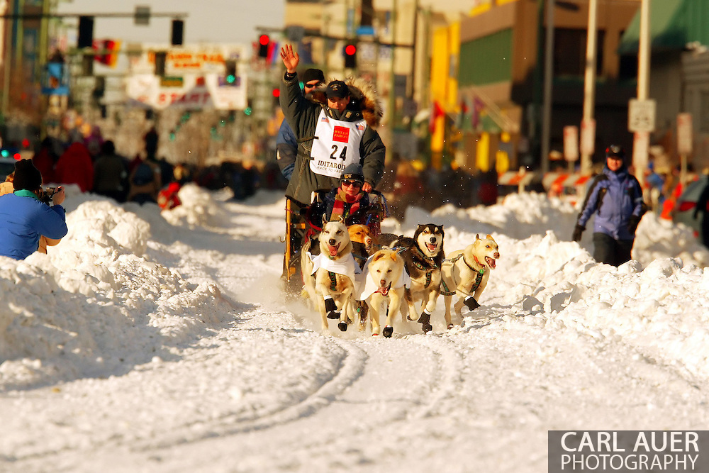3/3/2007:  Anchorage Alaska -  Rookie Jon Korta of Galena, AK waves to the crowds during the Ceremonial Start of the 35th Iditarod Sled Dog Race