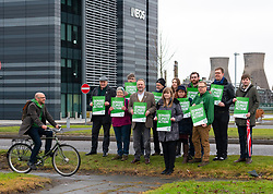 Grangemouth, Scotland, UK. 7th December 2019. Scottish Greens co-leader Patrick Harvie joined Linlithgow and East Falkirk candidate Gillian Mackay for a demonstration outside INEOS offices in Grangemouth. The refinery operated there by INEOS is Scotland's biggest polluter according to the Greens. The Scottish Greens are calling for the end of shale gas imports, which bring fracked gas from the US to Grangemouth.<br /> Iain Masterton/Alamy Live News