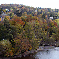 The houses overlookking the River Tay in Perth surrounded by the trees in their autumn colours<br />