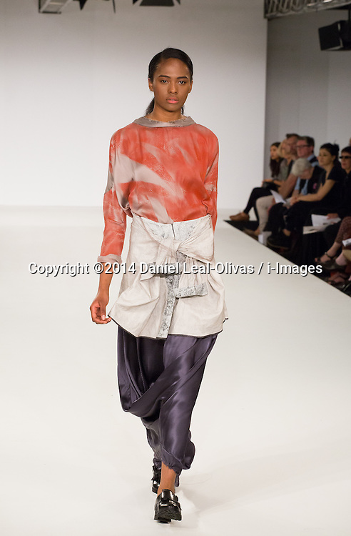 Graduate Fashion Week - Bath Spa & Norwich University of Arts. A model walks the runway from the Thomas Brookes collection during the Bath Spa University & Norwich University of the Arts show on the third day of the Graduate Fashion Week 2014 at The Truman Brewery, London, United Kingdom. Monday, 2nd June 2014. Picture by Daniel Leal-Olivas / i-Images