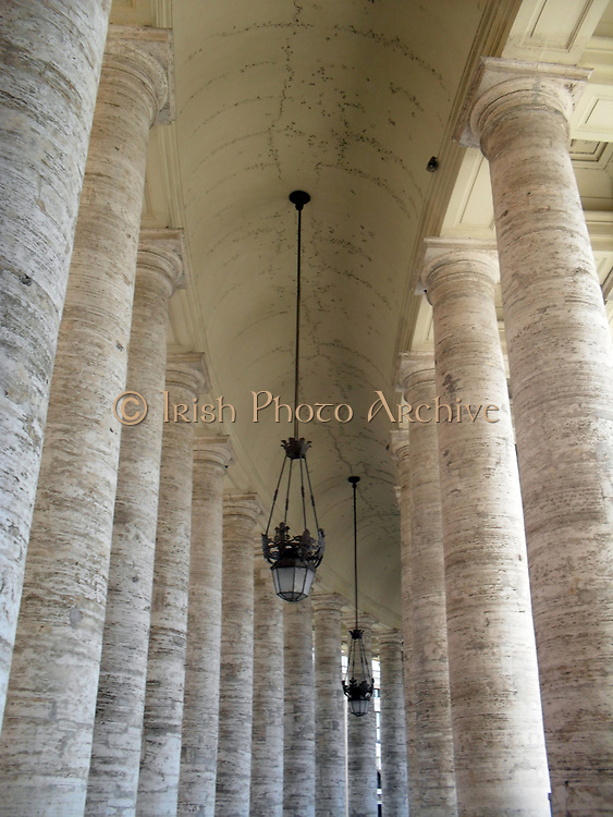 St. Peter's Basilica in the Vatican City, Italy. The church is the most renowned work of Renaissance architecture, and was designed by Donato Bramante, Michelangelo, Carlo Maderno and Gian Lorenzo Bernini. The original basilica is from 4th century AD, but the current design was completed in 1626. This image shows the multitude of columns.