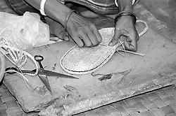 BANGLADESH DINAJPUR OCT94 - A woman makes Jute handicrafts for the fair trade NGO Tarango in rural Dinajpur, Kaharol Thana in northern Bangladesh. Tarago's products are sold primarily in Germany in support of the NGO's project activities in Bangladesh...jre/Photo by Jiri Rezac..© Jiri Rezac 1994