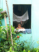Child in window, Kadavu Koro, Fiji.