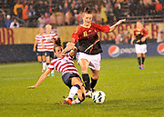 """U.S. Women's National Team defender Kelley O'Hara (5) slide tackles Germany's striker Anja Mittag (11) during the """"Fan Tribute Tour"""" game held at Rentschler Field in East Hartford, Connecticut on Tuesday, October 23, 2012. The U.S. tied with Germany 2-2."""