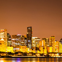 Chicago skyline at night panoramic photo. Picture includes Willis Tower (Sears Tower), CNA building, Trump Tower, Prudential buildings, BCBS, and many other downtown Chicago office buildings and skyscrapers. Panoramic photo ratio is 1:3.