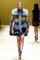 A model walks the runway wearing J. Mendel Fall 2014 during Mercedes-Benz Fashion Week in New York on February 12th, 2014